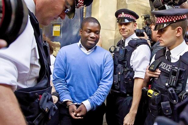 Adoboli in cuffs